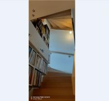 Escalier bibliothèque dans maison d'architecte par Caroline Thibault architecte